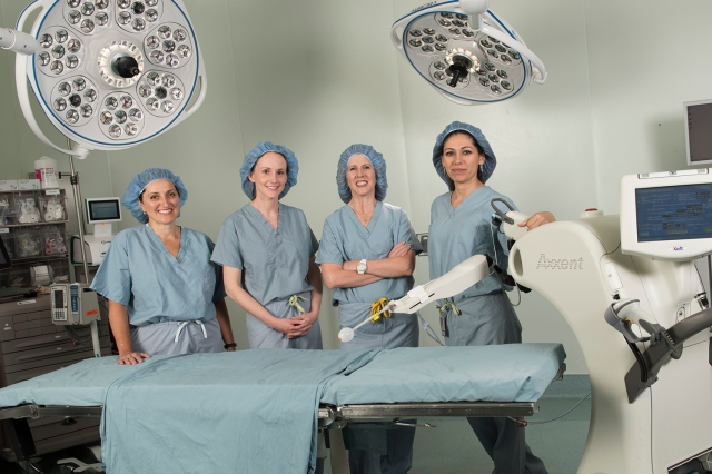 From left, breast surgeons Mary Ellen Greco, MD, Lisa Lai, MD, and Kristine Keeney, MD, and radiation oncologist Anna Shapiro, MD, in the operating room with the new intraoperative radiation therapy unit. (photos by Susan Kahn)