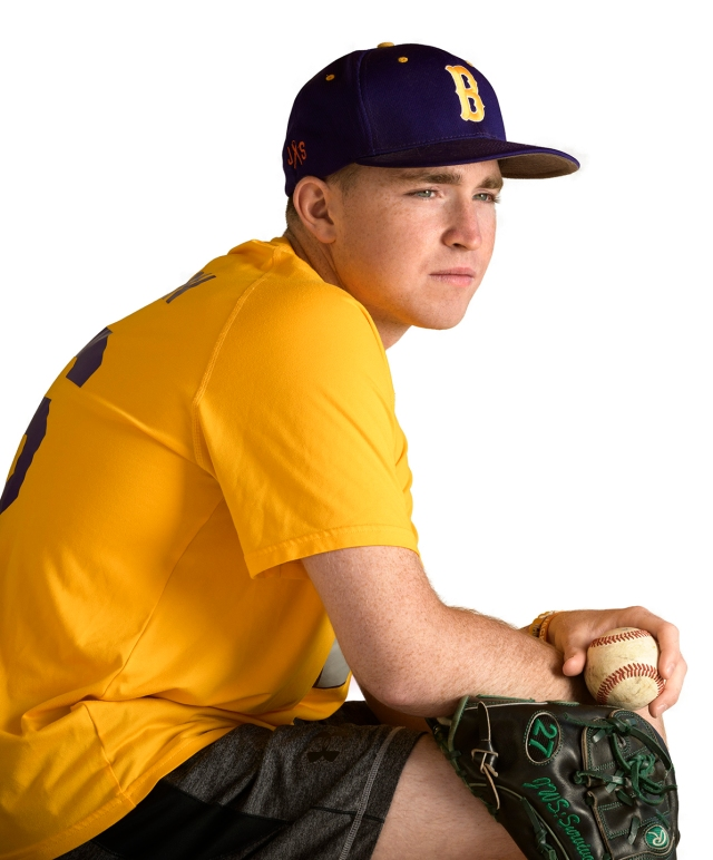 Baseball pitcher and cancer survivor Jack Sheridan, now a sophomore at Le Moyne College, is shown in the team colors of his high school, Christian Brothers Academy. He is a board member of On My Team16, a charity to help children hospitalized for cancer. (photos by Robert Mescavage)
