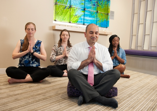Kaushal Nanavati, MD, leads meditation in the meditation room at the Upstate Cancer Center. In the back, from left, are medical students Megan Taggart and Alison Stedman and intern Amani Mike. (photo by Susan Kahn)