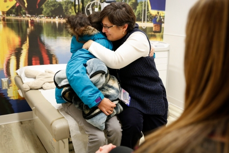 Upstate pediatric cancer chief Melanie Comito, MD, gives Lola a goodbye hug.