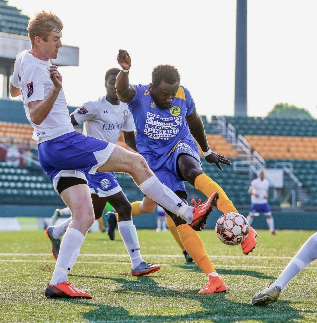 Upstate nurse Isaac Kissi, playing for the Rochester Lancers in the blue jersey, has played soccer both professionally and for fun (photos by Rob Daniels)
