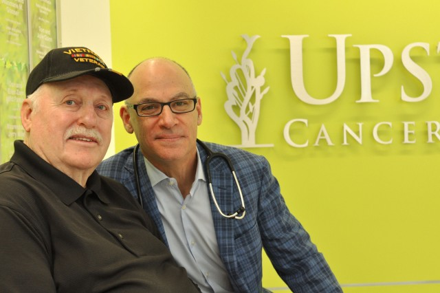 Jan Roberts, left, with radiation oncologist Jeffrey Bogart, MD. Roberts wears a cap that honors those, like him, who served in Vietnam, especially those who didn't come back. (photo by Richard Whelsky)