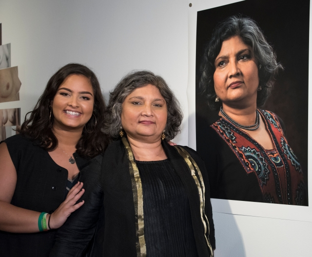 "Tula Goenka, center, with her daughter, Ranya Shannon, who was 9 when Goenka was diagnosed with breast cancer, standing next to Cindy Bell's portrait of Goenka at the ""Look Now"" exhibition. (This and the following photos taken at the opening of the exhibit are by Susan Kahn; the Look Now"" exhibition portraits shown are by Cindy Bell)"