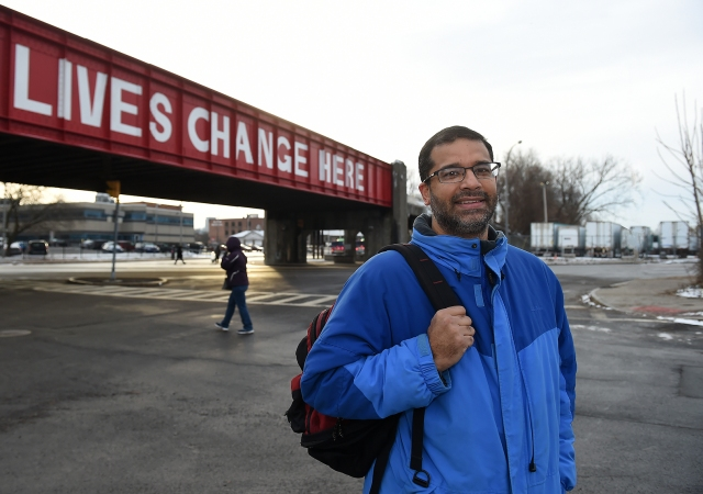 Sunny Aslam, MD, shown at the Gifford Street railroad overpass near the Rescue Mission in Syracuse, offers mental health care to the homeless. (photo by John Berry)