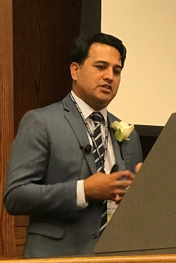 Patrick Basile, MD, '03, giving a lecture at Upstate in 2018.