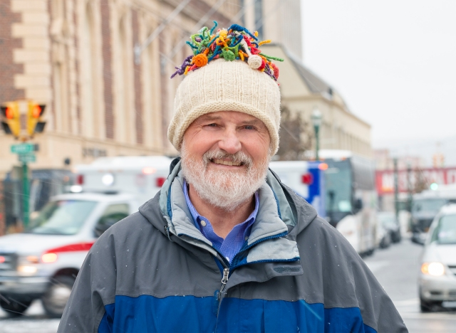David Lehmann, MD, dispenses medical care to homeless people in Syracuse. He accompanies workers from In My Father's Kitchen, which distributes food and clothing to the needy. (photo by Robert Mescavage)