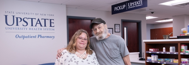 Heidi King with Reginald Sanford at the Upstate Outpatient Pharmacy. (photos by Robert Mescavage)