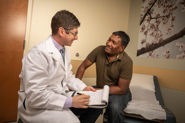 Urologist Dmitriy Nikolavsky, MD, left, and Hemant Tandi at an appointment. (photo by Robert Mescavage)