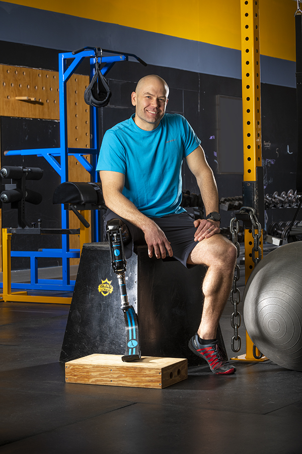Childhood cancer survivor Dan Kosick of Endicott is shown at Synergy Athletics fitness center, where he trains and works out. (photo by Robert Mescavage)