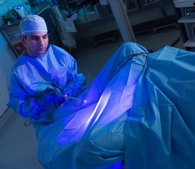Joseph Jacob, MD, demonstratesBlue Light Cystoscopy. Bladdercancer is the fourth most common cancer in American men, but it'sless common in women. The most common symptom is blood in the urine, which is never normal. (photo by Susan Kahn)