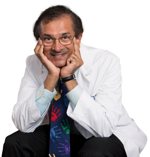 Neurosurgeon Satish Krishnamurthy, MD. He is wearing a necktie from the charitable organization Save the Children in honor of his many pediatric patients. (photo by Susan Kahn)