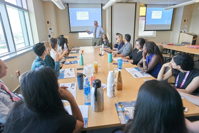 Pediatrics chair Gregory Conners, MD, greets the new pediatric medical residents — all doctors who began three years of training at Upstate in July. Seated next to Conners is pediatric hematologist/oncologist Gloria Kennedy, MD. (photo by Chuck Wainwright)