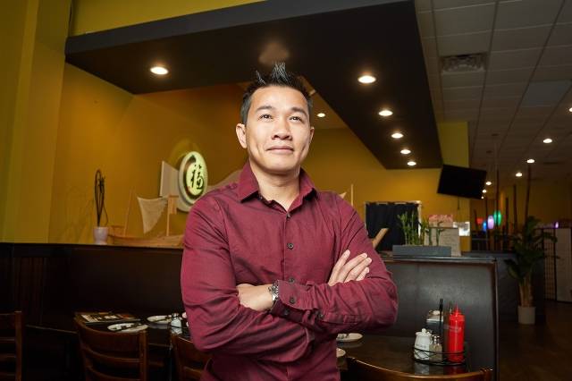Upstate nurse Thanh Nguyen at the Saigon Vietnamese Kitchen, his restaurant outside Liverpool. (photo by Chuck Wainwright)