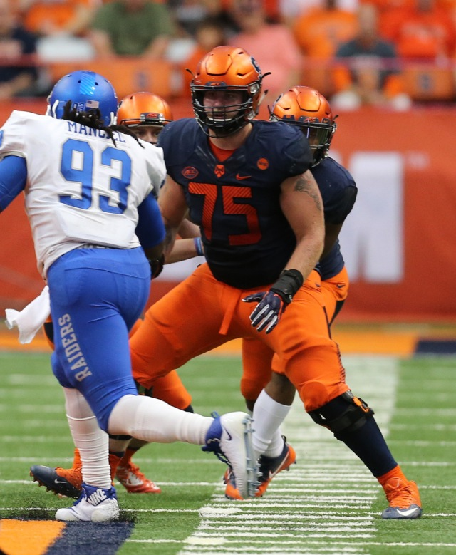 Heckel, (No. 75), blocks defensive tackle Malik Manciel (No. 93) during an SU vs. Middle Tennessee State University game. (photo courtesy of Syracuse University Athletics)