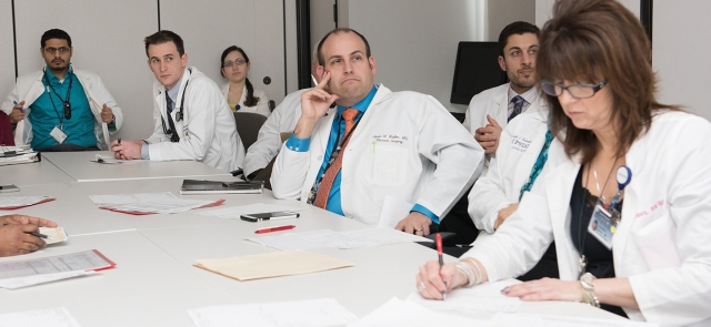 Jason Wallen, MD, center, contemplates a treatment plan for a lung cancer patient during a TOP multidisciplinary team meeting. (photo by Susan Kahn)