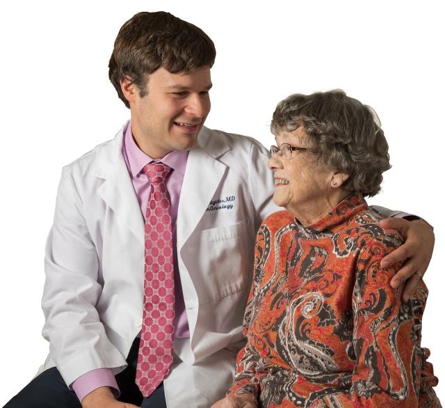 Radiation oncologist Paul Aridgides, MD, with Joan Gorton of Hamilton (photo by Robert Mescavage)