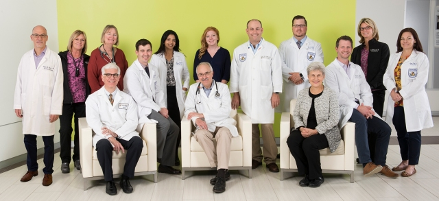 The TOP (lung cancer) team includes, from left:Jeffrey Bogart, MD, radiation oncology; Terri Harrington, RN; Carolyn Walczyk, tobacco treatment counselor; Ernest Scalzetti, MD, radiology (seated); Michael Archer, DO, thoracic surgery; Manju Paul, MD, pulmonology; Stephen Graziano, MD, oncology (seated); Erin Bingham, clinical research associate; Jason Wallen, MD, thoracic surgery; Mark Crye, MD, thoracic surgery; Leslie Kohman, MD, director emerita (seated); Michael Mix, MD, radiation oncology (seated); Heather Smith, RN; and Ginger Cowan, NP. (photo by Susan Kahn and William Mueller)