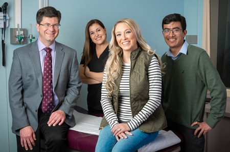 Farmer with her health care team, from left:Christopher Fortner, MD, PhD; nurseAshley Waterman; and Sumendra Joshi, MBBS.