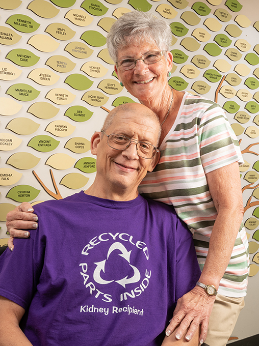 """Preston, pictured with his wife, Carol, enjoys wearing his """"recycled parts"""" T-shirt to encourage kidney donation. (photo by Robert Mescavage)"""