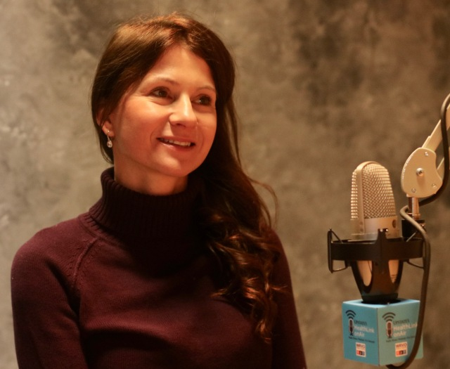 """Pediatric infectious disease specialist Jana Shaw, MD, shown here in a 2018 interview, speaks about COVID-19 with Upstate's radio show/podcast """"HealthLink on Air""""; to listen, see details at the end of this story. (photo by Jim Howe)"""