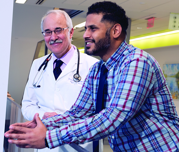 Nurse practitioner — and cancer survivor — Ibrahim Thabet, right, with his Upstate oncologist and colleague, Stephen Graziano, MD. (photo by Susan Kahn)