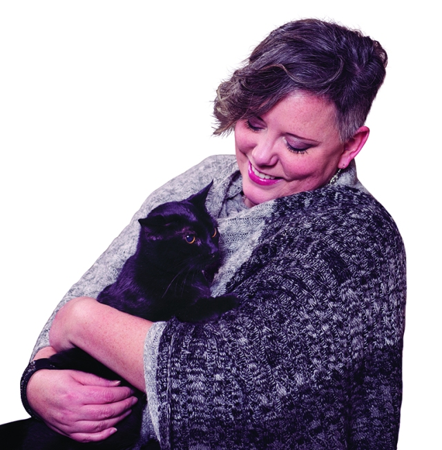 Christina Wallace with her cat, Gracie, who helped her find a lump. (photo by Susan Kahn)